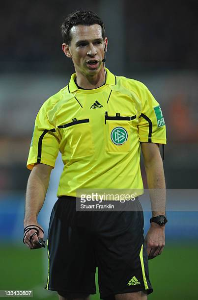 Referee Christian Bandurski ponders during the Second Bundeslga match between SC Paderbornand Karlsruher SCat the Energie Team Arena on November 18...