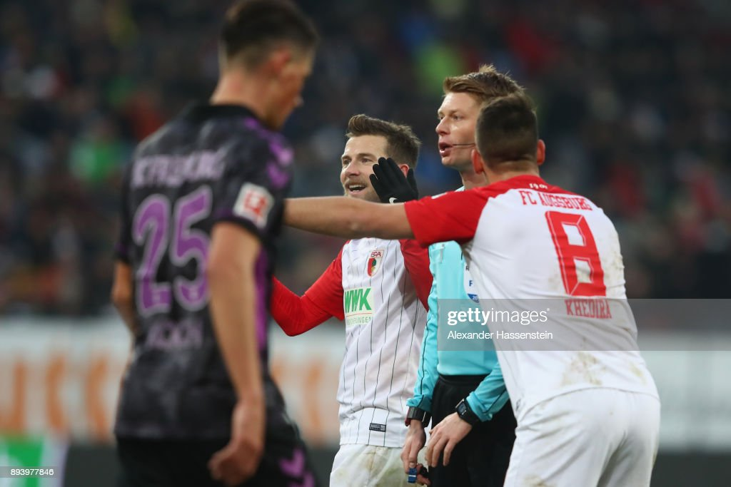 Referee Christian Dingert reacts during the Bundesliga match between FC Augsburg and Sport-Club Freiburg at WWK-Arena on December 16, 2017 in Augsburg, Germany.