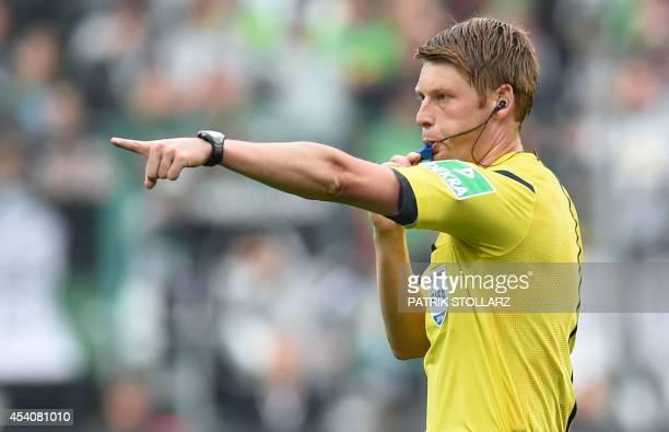Referee Christian Dingert reacts during the German first division Bundesliga football match Borussia Moenchengladbach v VfB Stuttgart at Borussia...