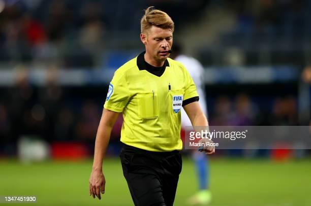 Referee Christian Dingert reacts during the Second Bundesliga match between Hamburger SV and Fortuna Düsseldorf at Volksparkstadion on October 16,...