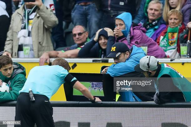 Referee Christian Dingert uses a video assistant to decide about penalty sichtet den Videobeweis during the Bundesliga match between Borussia...