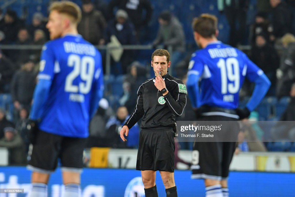 Referee Christof Guensch (C) whistles during the Second Bundesliga match between DSC Arminia Bielefeld and SG Dynamo Dresden at Schueco Arena on February 23, 2018 in Bielefeld, Germany.