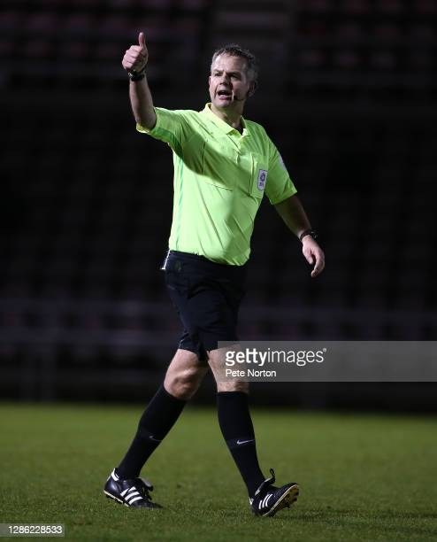 Referee Christopher Sarginson in action during the Papa John's Trophy match between Northampton Town and Stevenage at PTS Academy Stadium on November...
