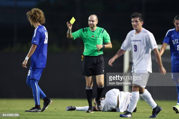 Referee Christopher Spivey shows the yellow card to Duke's Brandon Williamson The Duke University Blue Devils hosted the Presbyterian College Blue...