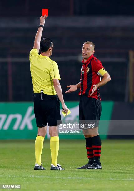 Referee Ciktor Kassai shows the red card for Djordje Kamber of Budapest Honved during the Hungarian OTP Bank Liga match between Budapest Honved and...