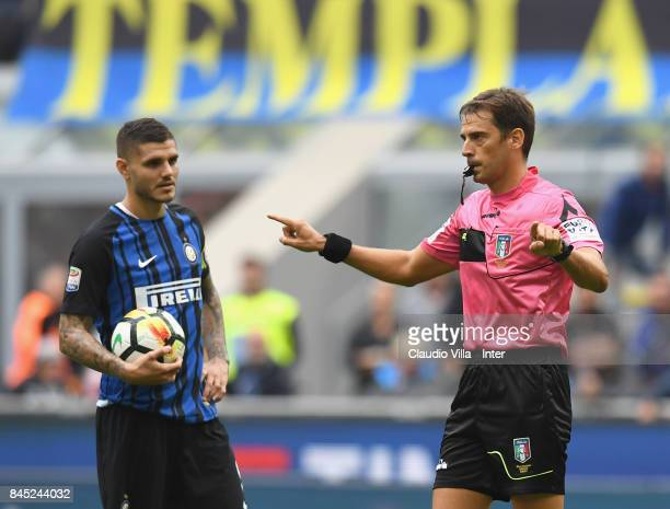Referee Claudio Gavillucci examines the new system VAR during the Serie A match between FC Internazionale and Spal at Stadio Giuseppe Meazza on...