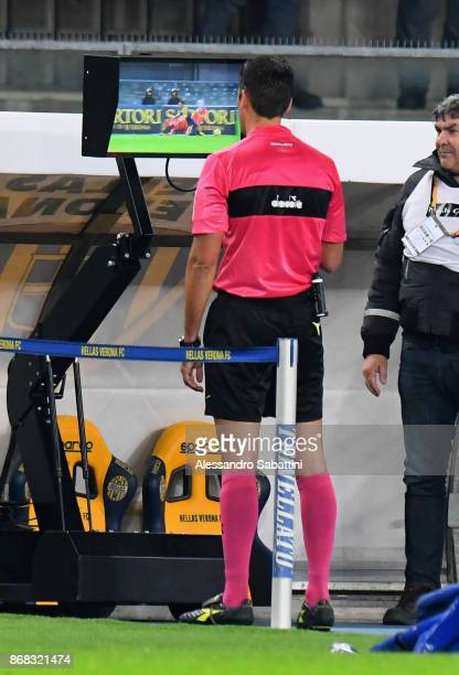 Referee Claudio Gavillucci examines the new system VAR during the Serie A match between Hellas Verona FC and FC Internazionale at Stadio Marc'Antonio...