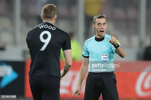 Referee Clement Turpin argues with Chris Wood of New Zealand during a second leg match between Peru and New Zealand as part of the 2018 FIFA World...