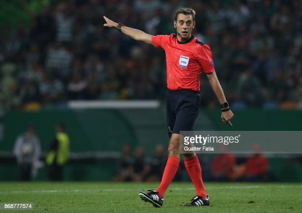 Referee Clement Turpin from France in action during the UEFA Champions League match between Sporting Clube de Portugal and Juventus at Estadio Jose...