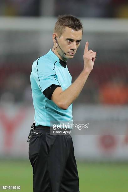 Referee Clement Turpin gestures during a second leg match between Peru and New Zealand as part of the 2018 FIFA World Cup Qualifier Playoff at...