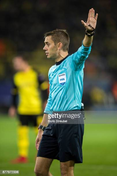 Referee Clement Turpin gestures during the UEFA Champions League group H match between Borussia Dortmund and Tottenham Hotspur at Signal Iduna Park...
