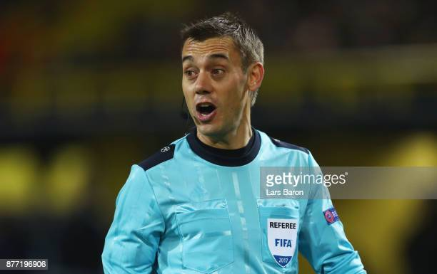 Referee Clement Turpin looks on during the UEFA Champions League group H match between Borussia Dortmund and Tottenham Hotspur at Signal Iduna Park...