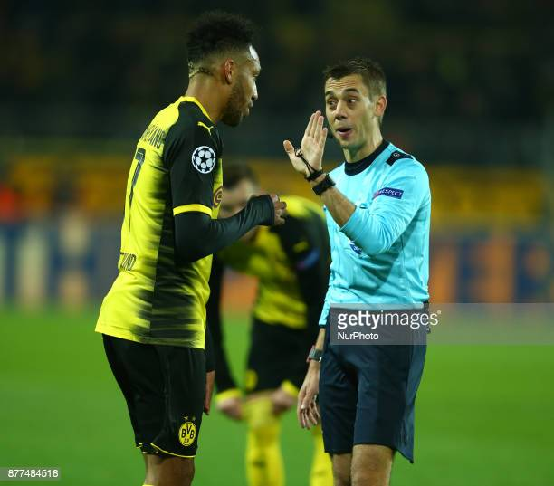Referee Clement Turpin of France having words with ierreEmerick Aubameyang of Borussia Dortmund during UEFA Champion League Group H Borussia Dortmund...