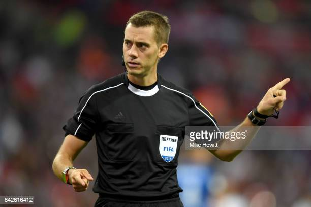 Referee Clement Turpin points during the FIFA 2018 World Cup Qualifier between England and Slovakia at Wembley Stadium on September 4 2017 in London...
