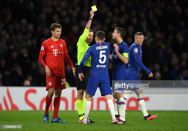 Referee Clement Turpin shows a yellow card to Jorginho of Chelsea meaning he will miss the second leg of the match during the UEFA Champions League...