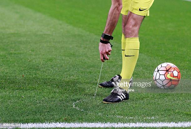 Referee Clement Turpin spray a line during the French Cup between Paris SaintGermain and Lyon at Parc Des Princes on february 10 2016 in Paris France