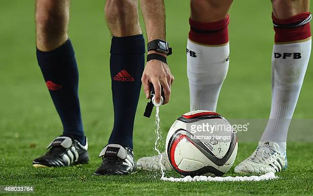 Referee Clement Turpin uses the vanishing spray, also known as vanishing foam out to mark a line during the EURO 2016 Group D Qualifier match between...