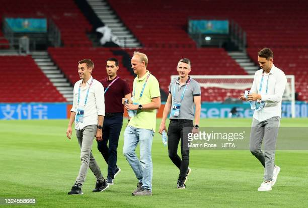 Referee Clément Turpin and his assistant referees inspecting the pitch during the Referees walk around ahead of the UEFA Euro 2020 Group B match...