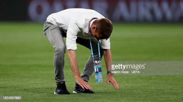 Referee Clément Turpin is inspecting the pitch during the Referees walk around ahead of the UEFA Euro 2020 Group B match between Russia and Denmark...