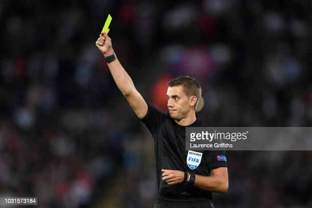 Referee Clément Turpin shows a yellow card during the international friendly match between England and Switzerland at The King Power Stadium on...