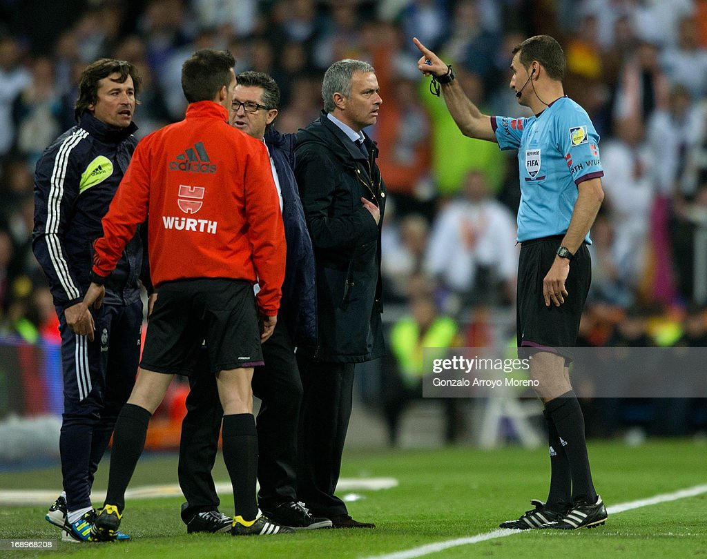 Referee Clos Gomez asks head coach Jose Mourinho of Real Madrid CF to leave the pitch during the Copa del Rey Final match between Real Madrid CF and Club Atletico de Madrid at Estadio Santiago Bernabeu on May 17, 2013 in Madrid, Spain.