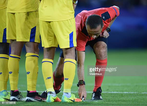 Referee Cüneyt Çakr uses his vanishing spray during the UEFA Champions League match between Leicester City FC and FC Porto at The King Power Stadium...
