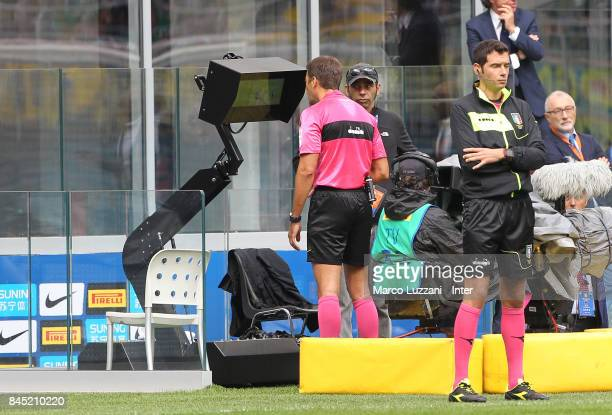 A referee consults the VAR during the Serie A match between FC Internazionale and Spal at Stadio Giuseppe Meazza on September 10 2017 in Milan Italy