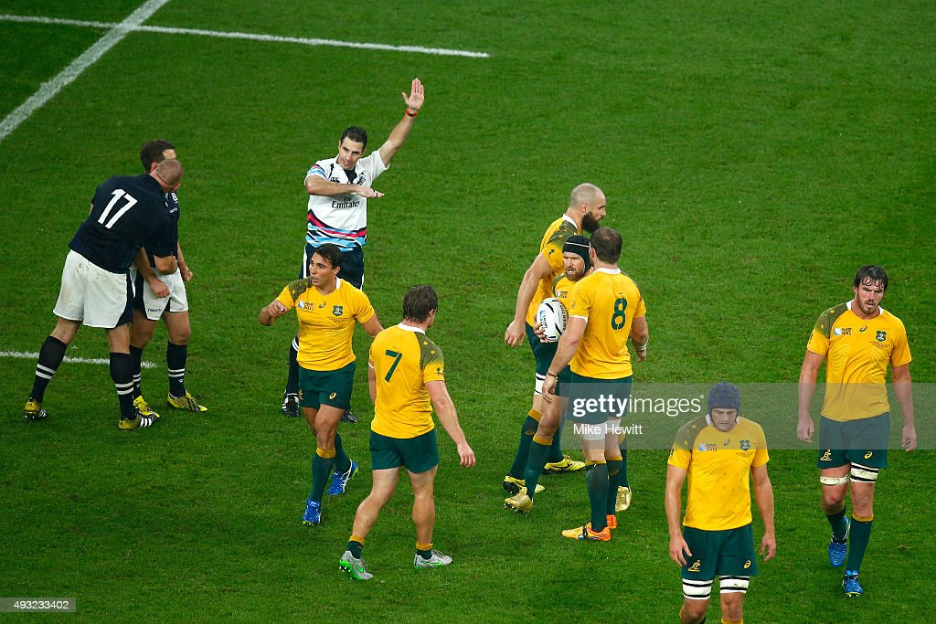 Referee Craig Joubert awards Australia a late match winning penalty during the 2015 Rugby World Cup Quarter Final match between Australia and Scotland at Twickenham Stadium on October 18, 2015 in London, United Kingdom.