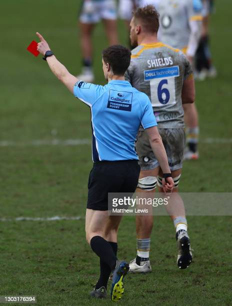 Referee Craig Maxwell-Keys awards a red card to Kieran Brookes of Wasps during the Gallagher Premiership Rugby match between Leicester Tigers and...