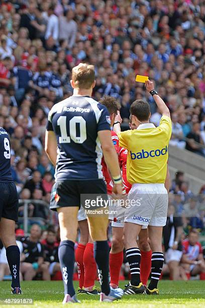 referee Craig MaxwellKeys shows a yellow card to Army's Thomas Chennell during the Babcock Trophy rugby union match between The British Army and the...