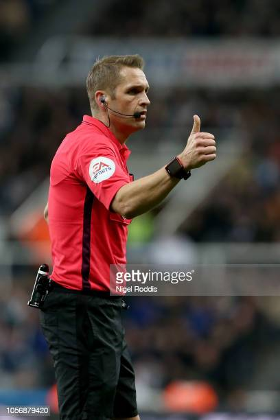Referee Craig Pawson guestures during the Premier League match between Newcastle United and Watford FC at St James Park on November 3 2018 in...