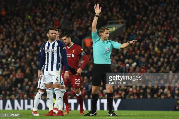 Referee Craig Pawson indicates a goalkick after consulting the VAR and disallowing their third goal during the English FA Cup fourth round football...