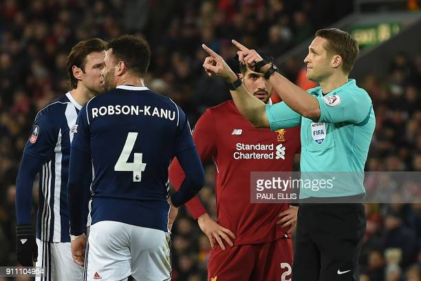 Referee Craig Pawson indicates that he's going to the VAR before disallowing their third goal during the English FA Cup fourth round football match...