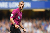 london england referee craig pawson looks