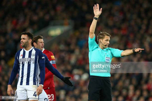 Referee Craig Pawson makes a decision via VAR during The Emirates FA Cup Fourth Round match between Liverpool and West Bromwich Albion at Anfield on...