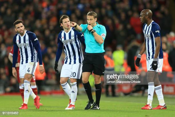 Referee Craig Pawson points to award a penalty following a decision to refer to the Video Assistant Referee system as Hal RobsonKanu of West Brom...