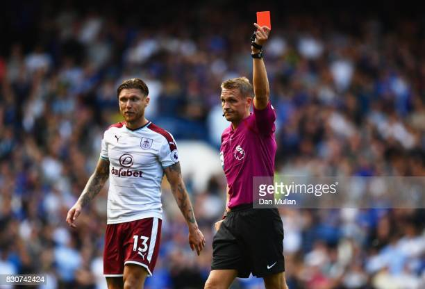 Referee Craig Pawson shows Cesc Fabregas of Chelsea a red card during the Premier League match between Chelsea and Burnley at Stamford Bridge on...