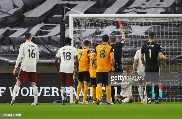 Referee, Craig Pawson shows David Luiz of Arsenal a red card during the Premier League match between Wolverhampton Wanderers and Arsenal at Molineux...