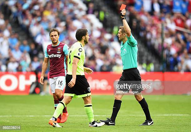 Referee Craig Pawson shows the red card to Harry Arter of AFC Bournemouth during the Premier League match between West Ham United and AFC Bournemouth...