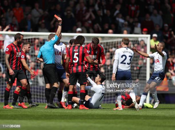 referee Craig Pawson shows the red card to HeungMin Son of Tottenham during the Premier League match between AFC Bournemouth and Tottenham Hotspur at...