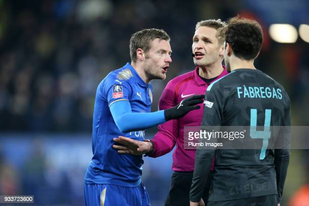 Referee Craig Pawson with Jamie Vardy of Leicester City and Cesc Fabregas of Chelsea during The Emirates FA Cup Quarter Final tie between Leicester...