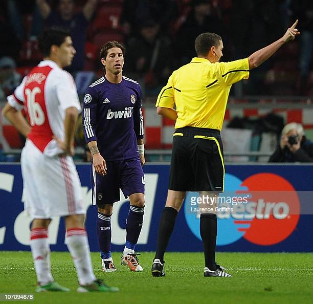 Referee Craig Thomson of Scotland sends off Sergio Ramos of Real Madrid for time wasting during the UEFA Champions League Group G match between AFC...