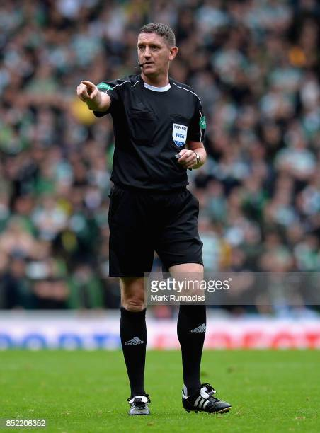 Referee Craig Thomson signals during the Ladbrokes Scottish Premiership match between Rangers and Celtic at Ibrox Stadium on September 23 2017 in...