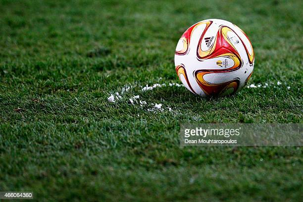Referee, Craig Thomson uses the vanishing spray, also known as vanishing foam out to mark a line for the ball during the UEFA Europa League Round of...