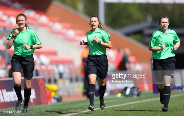 Referee Cristiana Hattersley and assistants Melissa Burgin and Lucy-Anne Briggs warm up prior to the Barclays FA Women's Super League match between...