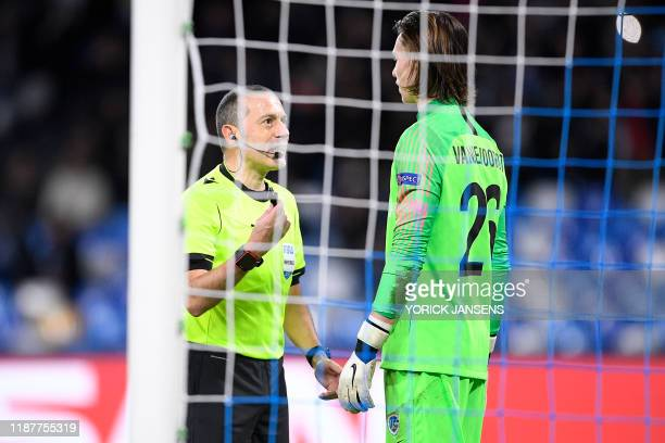 Referee Cuneyt Cakir and Genk's goalkeeper Maarten Vandevoordt pictured during the game between Belgian soccer team KRC Genk and Italian club SSC...