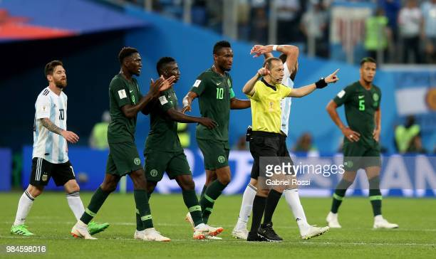 Referee Cuneyt Cakir announces a VAR review during the 2018 FIFA World Cup Russia group D match between Nigeria and Argentina at Saint Petersburg...