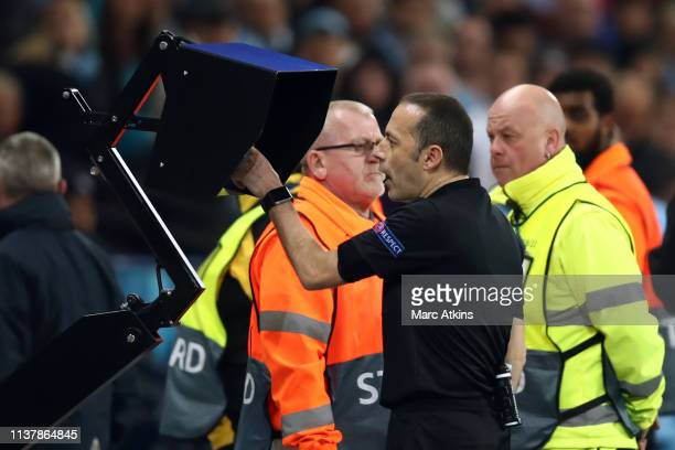 Referee Cuneyt Cakir checks the VAR system during the UEFA Champions League Quarter Final second leg match between Manchester City and Tottenham...