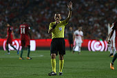 referee cuneyt cakir during match between