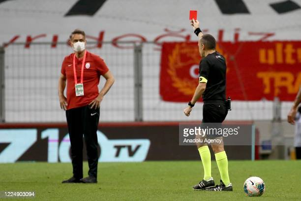 Referee Cuneyt Cakir shows a red card during the Turkish Super Lig week 30 football match between Galatasaray and Trabzonspor at Turk Telekom Stadium...